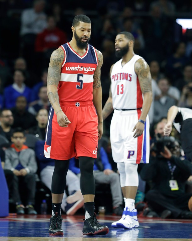 . Washington Wizards forward Markieff Morris (5) walks by Detroit Pistons forward Marcus Morris (13) during the first half of an NBA basketball game, Saturday, Jan. 21, 2017, in Auburn Hills, Mich. (AP Photo/Carlos Osorio)