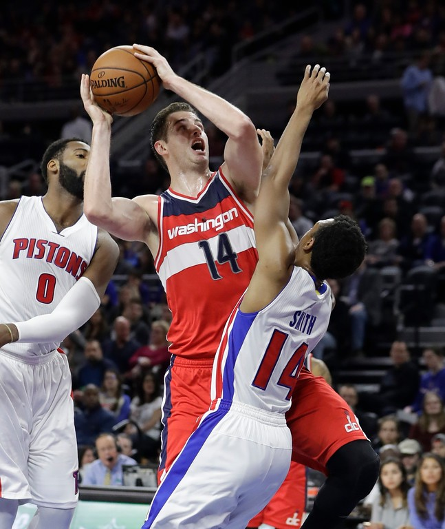 . Washington Wizards forward Jason Smith (14) shoots over Detroit Pistons guard Ish Smith (14) during the second half of an NBA basketball game, Saturday, Jan. 21, 2017, in Auburn Hills, Mich. (AP Photo/Carlos Osorio)