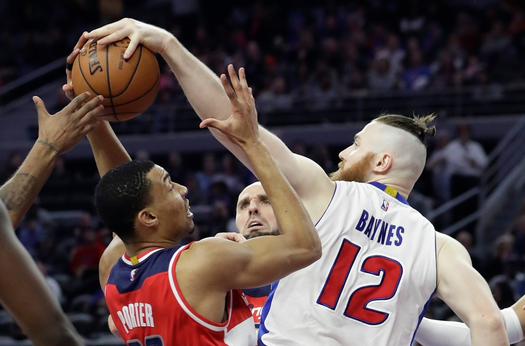 . Washington Wizards forward Otto Porter Jr., left, and Detroit Pistons center Aron Baynes (12) battle for the rebound during the second half of an NBA basketball game, Saturday, Jan. 21, 2017, in Auburn Hills, Mich. (AP Photo/Carlos Osorio)