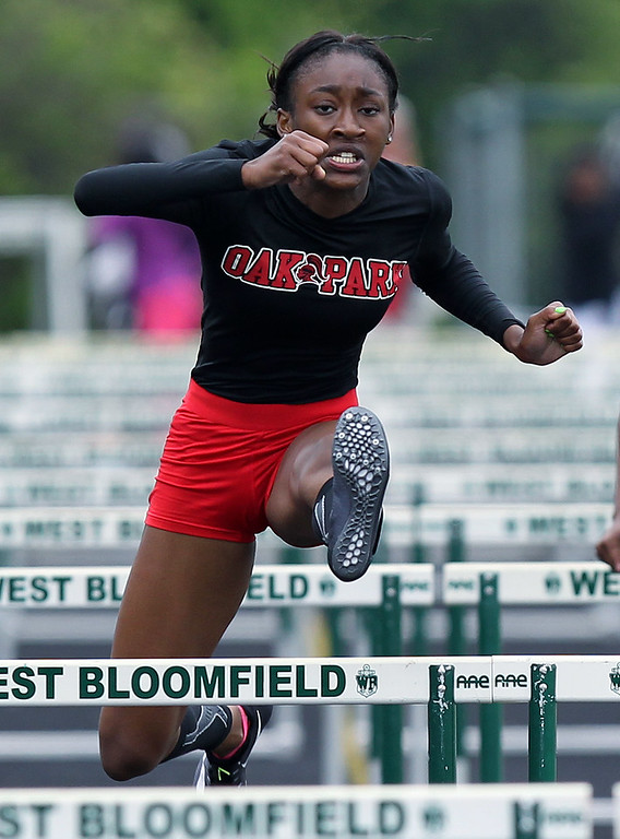 . Aasia Laurencin, Oak Park, took home first place honors in the 110-yard hurdles with a time of 14:28, which helped her squad win the Region 6 championship with a 117 points at West Bloomfield Saturday, May 19, 2018. (For The Oakland Press / LARRY McKEE)