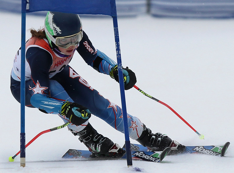 Kaylee Richardson, Rochester Adams, rounds a gate in the Giant Slalom during the MHSAA Division 1 Regional Championship ski meet at Mt. Holly Wednesday, Feb. 15, 2017. (MIPrepZone photo / LARRY McKEE)