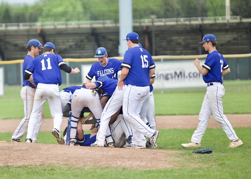 Rochester completed a 3 game sweep to claim a share of the OAA Red title with  13 - 5 and 2-1 victories over rival Rochester Adams Wednesday night.  (MIPrepZone photo by Tom Tomich)