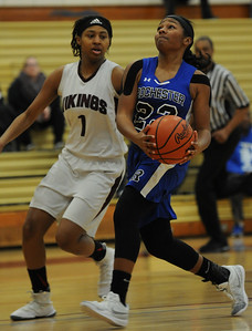 Tori Hawkins (23) of Rochester drives the lane as Hazel Park's Jaysa Larkins (1) defends during the OAA Blue match up played on Park on Thursday January 10, 2019 at Hazel Park HS. The Falcons moved to 2-0 in league play with a 63-23 win.  (Digital First Media photo by Ken Swart)