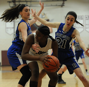 Hazel Park's Kiara Odoms is surrounded by Rochester's Jackie Hurst (L) and Laura Kucera (21) during the OAA Blue match up played on Thursday January 10, 2019 at Hazel Park HS. The Vikings lost to the Falcons 63-23.  (Digital First Media photo by Ken Swart)