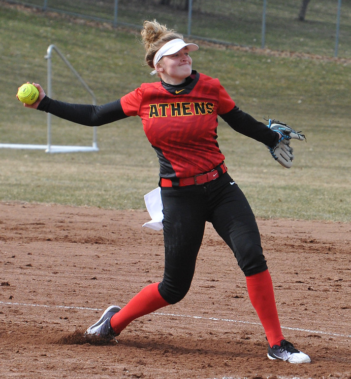 . Troy Athens pitcher Lanie Ellinger delivers a pitch during the OAA Crossover doubleheader against Rochester played on Tuesday April 10, 2018 at Rochester High School.  Ellinger earned an 11-0 win in 5 innings during game one. Rochester took the nightcap 8-1.  (Oakland Press photo by  Ken Swart)