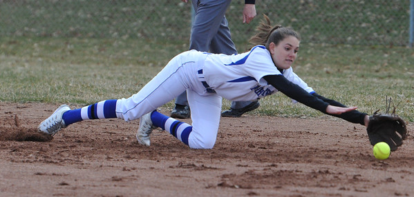 Rochester shortstop Megan Lorenzo makes a diving stop during the OAA Crossover doubleheader against Troy Athens played on Tuesday April 10, 2018 at Rochester High School.  The teams split with Athens taking the first game 11-0 in 5 innings, and Rochester winning the nightcap 8-1.  (Oakland Press photo by  Ken Swart)