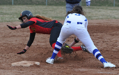 Rochester's Emily Morrow tags out Sydney Wickersham of Troy Athens at third base during the OAA Crossover doubleheader played on Tuesday April 10, 2018 at Rochester High School.  The teams split with Athens taking the first game 11-0 in 5 innings, and Rochester winning the nightcap 8-1.  (Oakland Press photo by  Ken Swart)