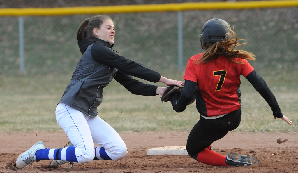 . Rochester\'s Megan Lorenzo tags out Troy Athens\' Abby Bright (7) at second base during the OAA Crossover doubleheader played on Tuesday April 10, 2018 at Rochester High School.  The teams split with Athens taking the first game 11-0 in 5 innings, and Rochester winning the nightcap 8-1.  (Oakland Press photo by  Ken Swart)
