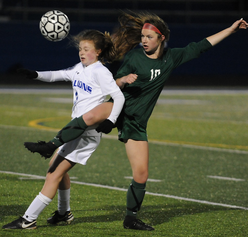. Rochester\'s Sidney Swart (L) and Novi\'s Riley Balconi (10) battle for the ball during the match played on Friday April 13, 2018 at Rochester HS.   Swart had the lone Rochester goal as the Wildcats defeated the Falcons 3-1. (Oakland Press Photo by Ken Swart)