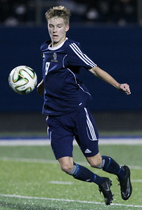 Evan Wilson, Rochester Stoney Creek, gains control of the ball during varsity soccer action at Rochester High School Tuesday, Sept. 19, 2017. The Falcons defeated their cross town rival Stoney Creek 3-0. (For The Oakland Press / LARRY McKEE)