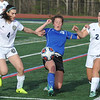 Royal Oak's Grace Morton (C) splits the defense of Country Day's Elle Hartje (4) and Sophia Gallette (21) during the match played on Monday April 24, 2017 at the Detroit Country Day School.  The Ravens lost to the Yellowjackets 3-1.<br />  (MIPrepZone photo by Ken Swart)