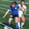 Royal Oak's Kira LaCombe (20) shields the ball from Country Day's Sophia Gallette during the match played on Monday April 24, 2017 at the Detroit Country Day School.  The Ravens lost to the Yellowjackets 3-1.<br />  (MIPrepZone photo by Ken Swart)