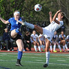 Country Day's Olivia Heppard (17) and Royal Oak's Sam Maurice (L) battle for the ball during the match played on Monday April 24, 2017 at the Detroit Country Day School.  The Yellowjackets defeated the Ravens 3-1.<br />  (MIPrepZone photo by Ken Swart)