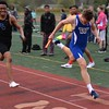 Walled Lake Western's Jack Dodge (right) beats Royal Oak's Marcus Jackson to the finish line in the 4 x 400 relay. Royal Oak's Ravens were at their best Friday at the annual Raider Relays where the boys and girls squads each won meet titles at North Farmington High School. Walled Lake Western's boys and Southfield's girls each placed second. (MIPrepZone photo gallery by MARVIN GOODWIN).