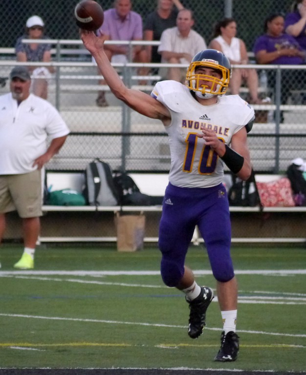 . Auburn Hills Avondale quarterback Adam Mather threw for one touchdown and ran for another vs. Royal Oak. (Oakland Press photo gallery by Jake Thielen)