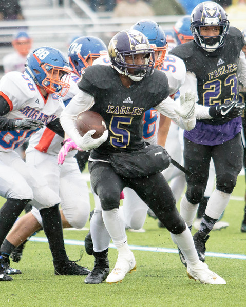 Madison Heights' J'Quan Jones eludes tacklers in the Eagles 14-7 District 7 semi-final loss to Saugatuck Saturday afternoon in Lansing.  (MIPrepZone photo by Timothy Arrick)