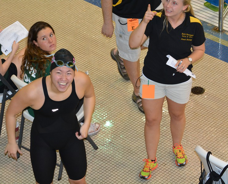 North Farmington's Hannah Chao  celebrates a finals-qualifying effort in the 50 freestyle. Birmingham Seaholm turned in several top-seeded efforts during the preliminary rounds of the Division 2 state swimming and diving championships Friday at Eastern Michigan University's Natatorium. (MIPrepZone photo gallery by MARVIN GOODWIN).
