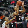 Deja Church (23) of Southfield A&T gets past East Kentwood's Maurya Barnes (1) during the MHSAA Class A State semi-final played on Friday March 17, 2017 at the Breslin Center in East Lansing.  Church has a game high 26 points but the Warriors lost to the Falcons 55-51.  (MIPrepZone photo by Ken Swart)