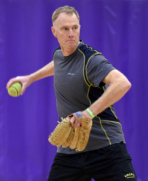 . Glen Campbell of Rochester Hills winds up to throw a pitch during softball practice at the Rochester Older Persons Commission on March 26, 2018. (Digital First Media Gallery by David Dalton)