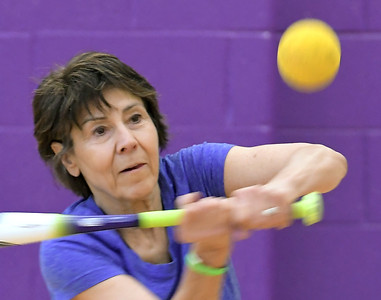Loraine Mazur of Rochester Hills swings at a ball during softball practice  at the Rochester Older Persons Commission on March 26, 2018. (Digital First Media Gallery by David Dalton)