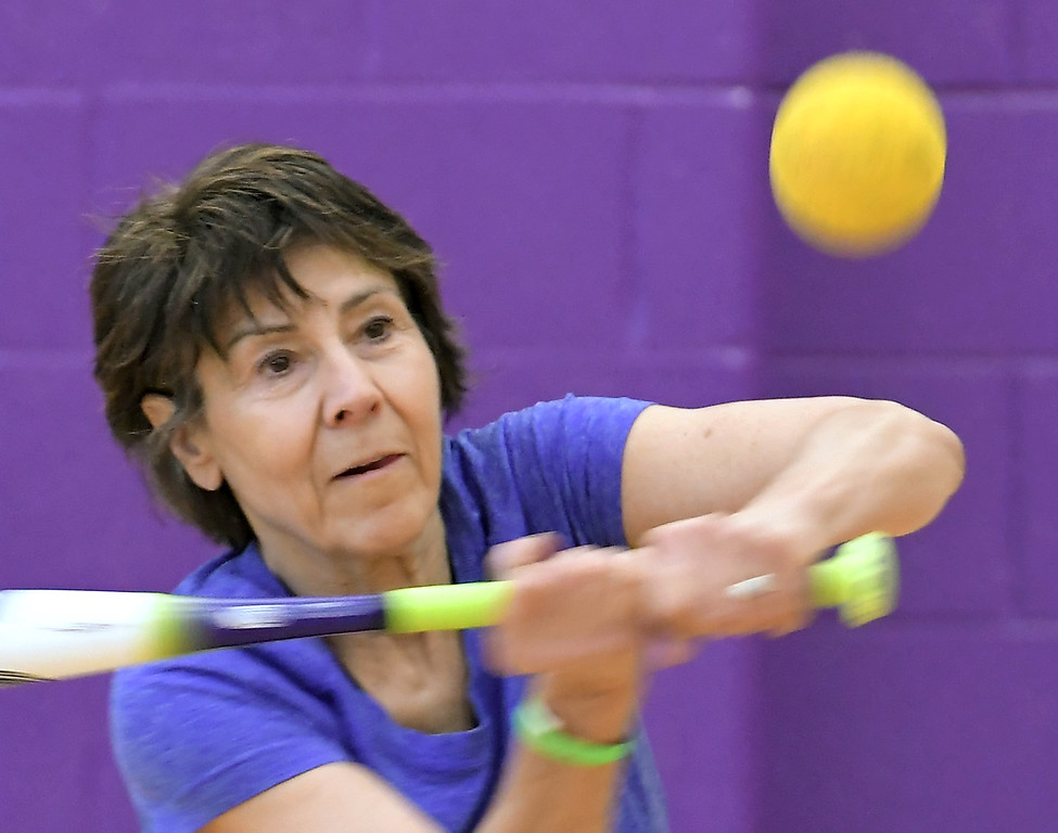 . Loraine Mazur of Rochester Hills swings at a ball during softball practice  at the Rochester Older Persons Commission on March 26, 2018. (Digital First Media Gallery by David Dalton)