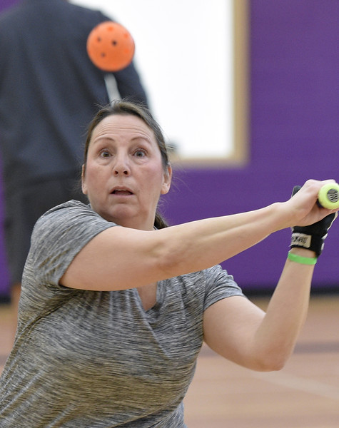Kathy Burgee of Romeo does keeps her eye on the ball during softball practice at the Rochester Older Persons Commission on March 26, 2018. (Digital First Media Gallery by David Dalton)