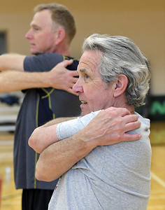 Hal Frederick of Rochester Hills does a stretching exercise during softball practice at the Rochester Older Persons Commission on March 26, 2018. (Digital First Media Gallery by David Dalton)