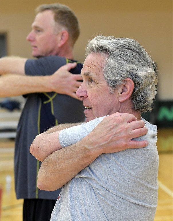 . Hal Frederick of Rochester Hills does a stretching exercise during softball practice at the Rochester Older Persons Commission on March 26, 2018. (Digital First Media Gallery by David Dalton)