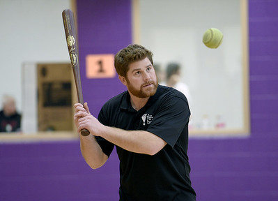 Fitness & Aquatics Director Matthew Spierling sets up a fielding drill during softball practice at the Rochester Older Persons Commission on March 26, 2018. (Digital First Media Gallery by David Dalton)