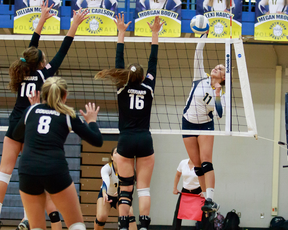. Cailey Carlson drives home the final point of the night as South Lyon took a straight set victory 25-16, 25-15, and 25-16 over in town rival South Lyon East 14-1-2 on the season. (Oakland Press photo by Timothy Arrick)