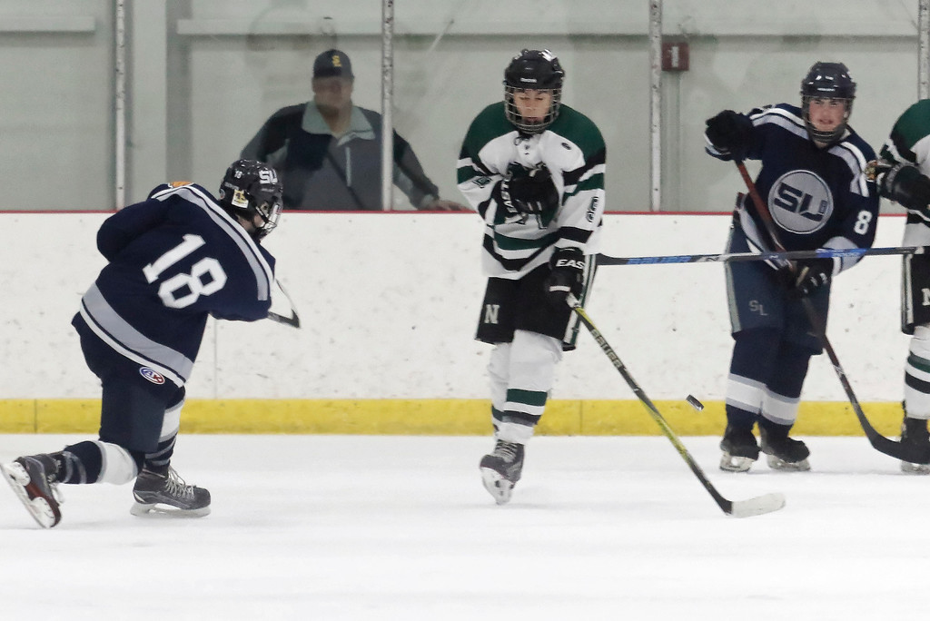 . Ashton Jones (18) lets the puck fly for his second goal of the night for South Lyon United as they defeated Novi 4-3 Tuesday February 27, 2018 in Novi to move on to the Regional Final match-up on Saturday against the winner of Livonia Stevenson and Canton. (Oakland Press photo by Timothy Arrick)