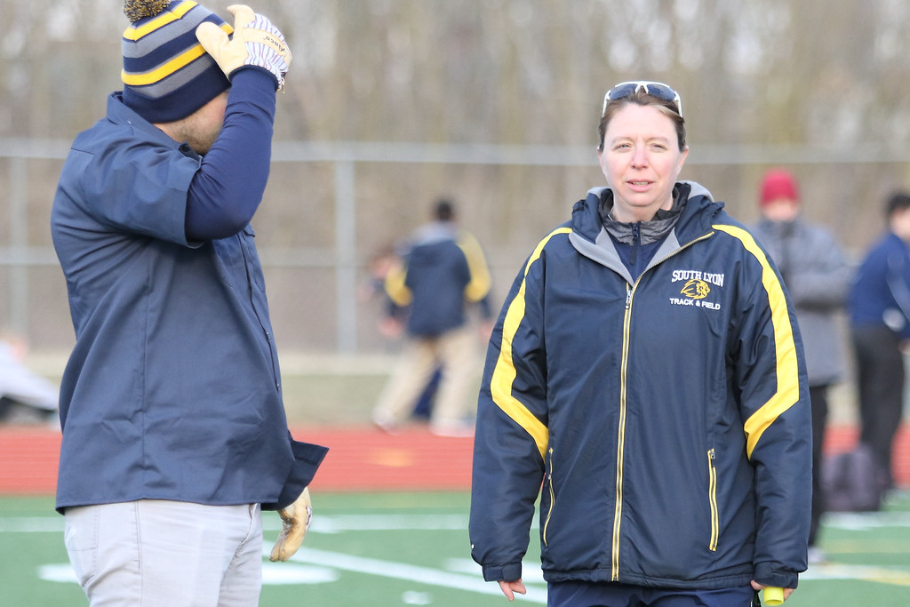 . Spring finally started to show its head Tuesday afternoon as temperatures warmed slightly and Millford, Walled Lake Central, and South Lyon competed in a tri-meet in South Lyon. (Oakland Press photo by Timothy Arrick)