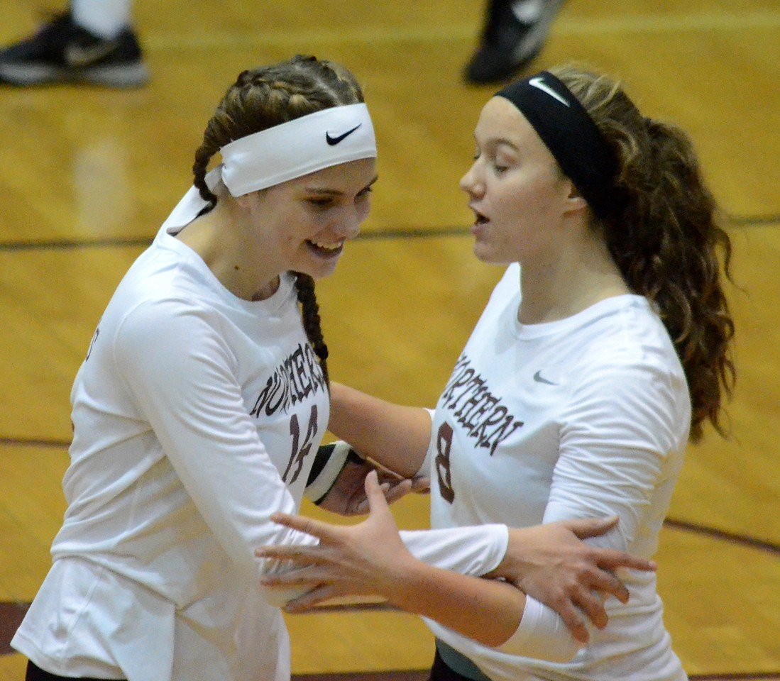 South Lyon completed a perfect run through the Lakes Valley Conference on Tuesday with a 25-22, 25-16, 25-14 win over Walled Lake Northern on Tuesday. (Oakland Press photo by Drew Ellis)