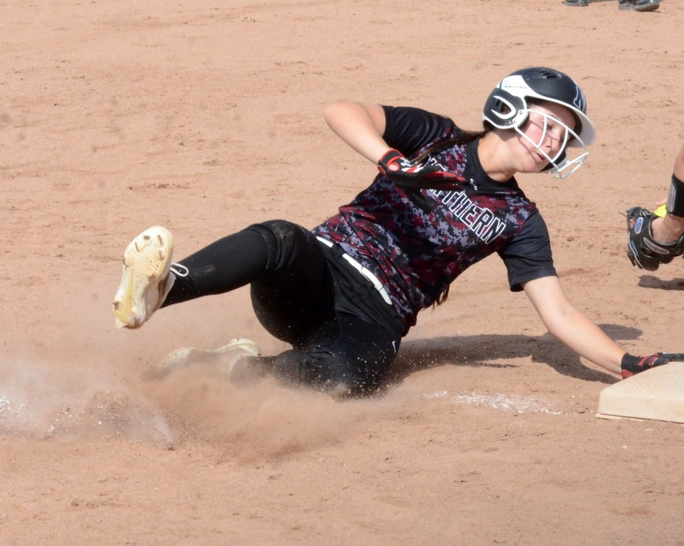 . The South Lyon and Walled Lake Northern softball teams split a pair of 6-3 games on Wednesday at South Lyon High School. (Oakland Press photo gallery by Drew Ellis)