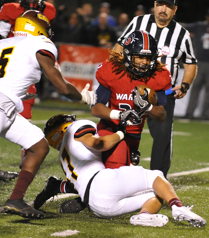 . Southfield A&T\'s Eric Mcarn is brought down by Davison\'s Caleb Smith as Carrington Terry (5) moves in to help during the Xenith Prep Kickoff Classic game played on Thursday August 24, 2017 at Wayne State University. The Cardinals defeated the Warriors 56-54 in triple overtime.  (Oakland Press Photo by Ken Swart)