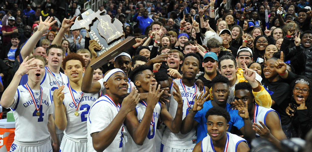 . The Southfield Christian Eagles celebrate the Class D State Championship they earned by defeating Buckley 64-54 in the game played on Saturday March 24, 2018 at The Breslin Center in East Lansing.  (Oakland Press photo by Ken Swart)