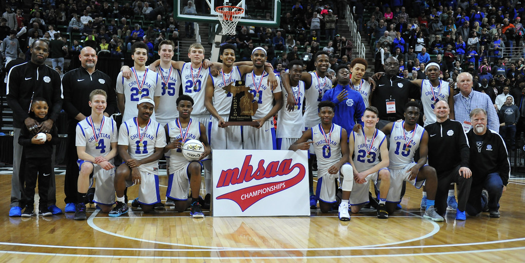 . Southfield Christian shows off the Class D State Championship trophy they earned by defeating Buckley 64-54 in the game played on Saturday March 24, 2018 at The Breslin Center in East Lansing.  (Oakland Press photo by Ken Swart)