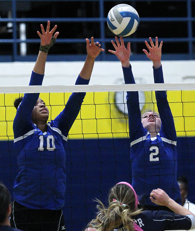 . Grace McFerrin (10) and Emily Van Dyke (2), Southfield Christian, go up for a block during Class D quarterfinal volleyball action against Fowler at Goodrich High School Tuesday, Nov. 14, 2017. The Eagles fell to Fowler (For The Oakland Press / LARRY McKEE)