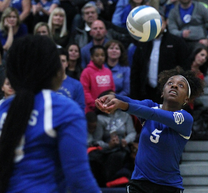 . Kaelin Ray (5), Southfield Christian, makes a dig during Class D quarterfinal volleyball action against Fowler at Goodrich High School Tuesday, Nov. 14, 2017. Southfield Christian fell to Fowler 3-0. (For The Oakland Press / LARRY McKEE)