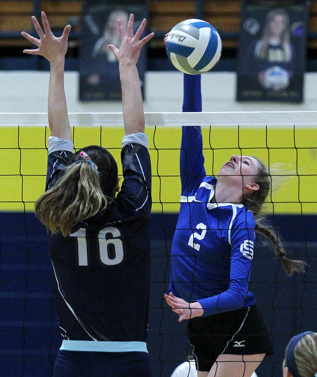 . Emily Van Dyke (2), Southfield Christian, makes a kill over the outstretched arms of Brooklyn Witgen, Fowler, during Class D quarterfinal volleyball action at Goodrich High School Tuesday, Nov. 14, 2017. Southfield Christian fell to Fowler 3-0. (For The Oakland Press / LARRY McKEE)