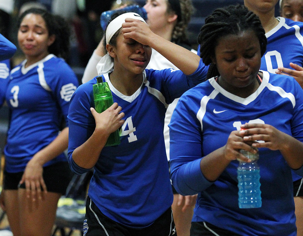. A dejected Grace Sanders (4), Southfield Christian, walks off the floor after falling to Fowler 3-0 in Class D quarterfinal volleyball action at Goodrich High School Tuesday, Nov. 14, 2017. Hayley Ellington (3) and Keirsten Mitchell (13), are also pictured. (For The Oakland Press / LARRY McKEE)