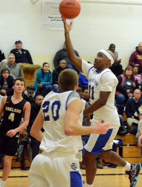 Southfield Christian earned a 79-50 win over Oakland Christian in the Class D regional semifinal at Marine City Cardinal Mooney Monday night. (Oakland Press photo gallery by Drew Ellis)