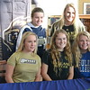 Stoney Creek athletes (left from top) Lauren Ingle, Mackenzie Wild, Erika Ward (far left bottom row), Truly Hoenig and Gina Cerny pose for a group photo during a Signing Day ceremony at the school on Wednesday. (Photo by Keith Dunlap)