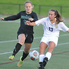 Stoney Creek's Izzy Paradoski (13) clears the ball away from Lake Orion's Marisa Szydlowski during the MHSAA D1 District quarterfinal played on Tuesday May 30, 2017 at Stoney Creek HS.  Paradoski had both goals to help lead the Cougars to a 2-0 win over the Dragons.  (MIPrepZone photo by Ken Swart)