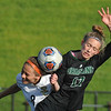 Stoney Creek's Emily Solek (8) and Lake Orion's Morgan Ham (17) battle for the ball during the MHSAA D1 District quarterfinal played on Tuesday May 30, 2017 at Stoney Creek HS.  The Cougars defeated the Dragons 2-0.  (MIPrepZone photo by Ken Swart)