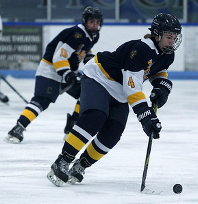 Ethan Adams (4), Clarkston, settles down the puck during varsity hockey action against Rochester Stoney Creek at the Onyx Ice Arena Friday, Jan. 4, 2019. Clarkston defeated Stoney Creek 4-2. (For The Oakland Press / LARRY McKEE)
