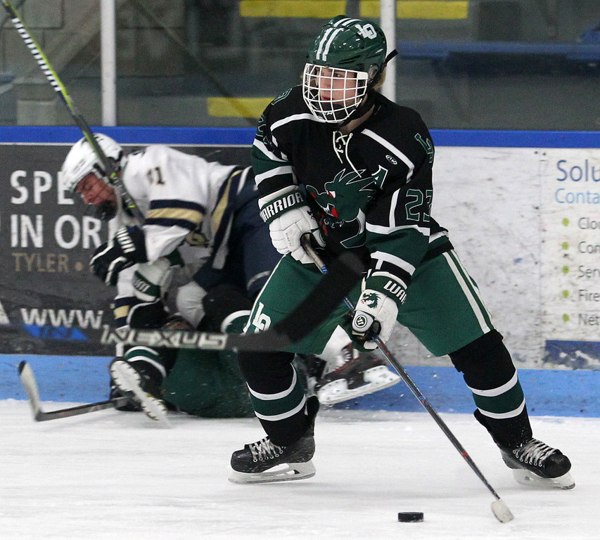 . Mitchel Burny, Lake Orion, looks for a teammate to pass to during varsity hockey action against Rochester Stoney Creek at the Onyx Ice Arena Saturday, Feb. 24, 2018. Lake Orion dominated late for a 3-2 win. (For The Oakland Press / LARRY McKEE)