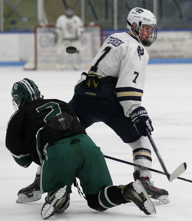 . Ben Terrien (7), Rochester Stoney Creek, makes a pass with his back turned over Thomas Reath, Lake Orion, during varsity hockey action at the Onyx Ice Arena Saturday, Feb. 24, 2018. The Cougars fell to Lake Orion 3-2. (For The Oakland Press / LARRY McKEE)