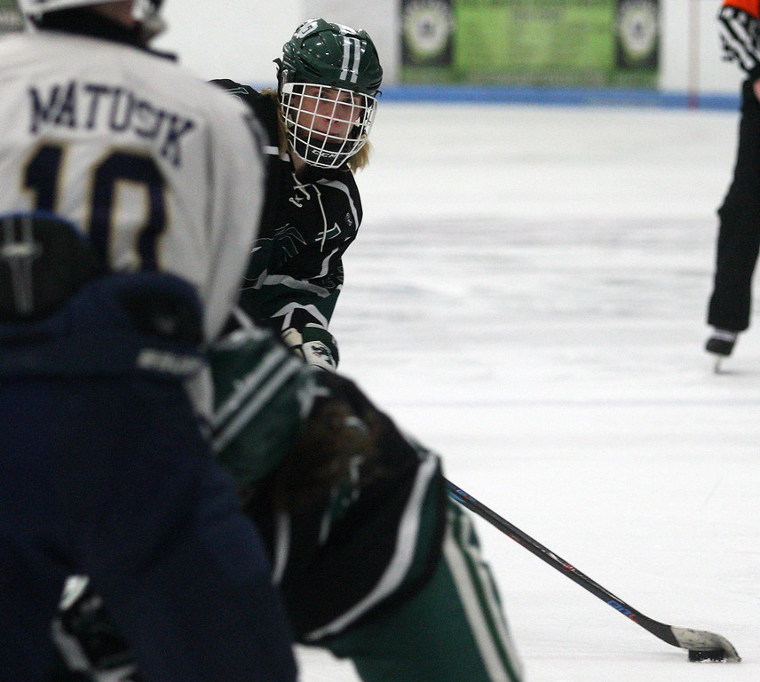 . Mitchel Burny, Lake Orion, gets ready to take a shot through a host of bodies during varsity hockey action against Rochester Stoney Creek at the Onyx Ice Arena Saturday, Feb. 24, 2018. Lake Orion dominated late for a 3-2 win. (For The Oakland Press / LARRY McKEE)
