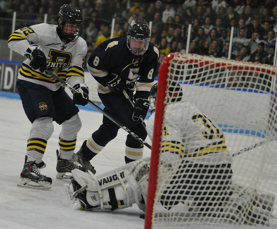 . Stoney Creek\'s Jake Joliet (8) scores the Cougars first goal between Rochester United\'s Cole Ferguson (22) and goalie Caleb Godlewski during the game played on Wednesday Nov. 22, 2017 at the Onyx Ice Arena in Rochester Hills.  The Cougars defeated RU 4-1. (Oakland Press Photo by Ken Swart)